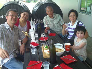 family sitting at a table in the Hunter Valley
