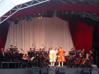 stage with singers and orchestra